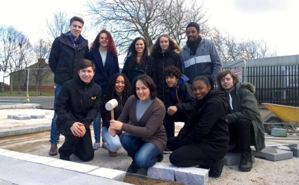 Young people's steering group lay stones in their new Tiber Square
